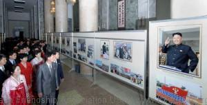 Displayed at the show hall are photos of Kim Jong Un, who is glorifying the party and state of the DPRK as glorious party and state of President Kim Il Sung and leader Kim Jong Il and demonstrating the independent dignity and power of Songun Korea.