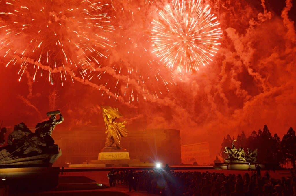 Fireworks explode before the 'Victorious Fatherland War Museum'