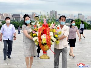 Floral Tribute Paid to Statues  of Kim Il Sung and Kim Jong Il.